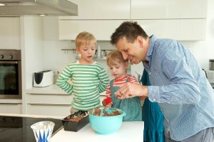 kids bake a cake with the Father